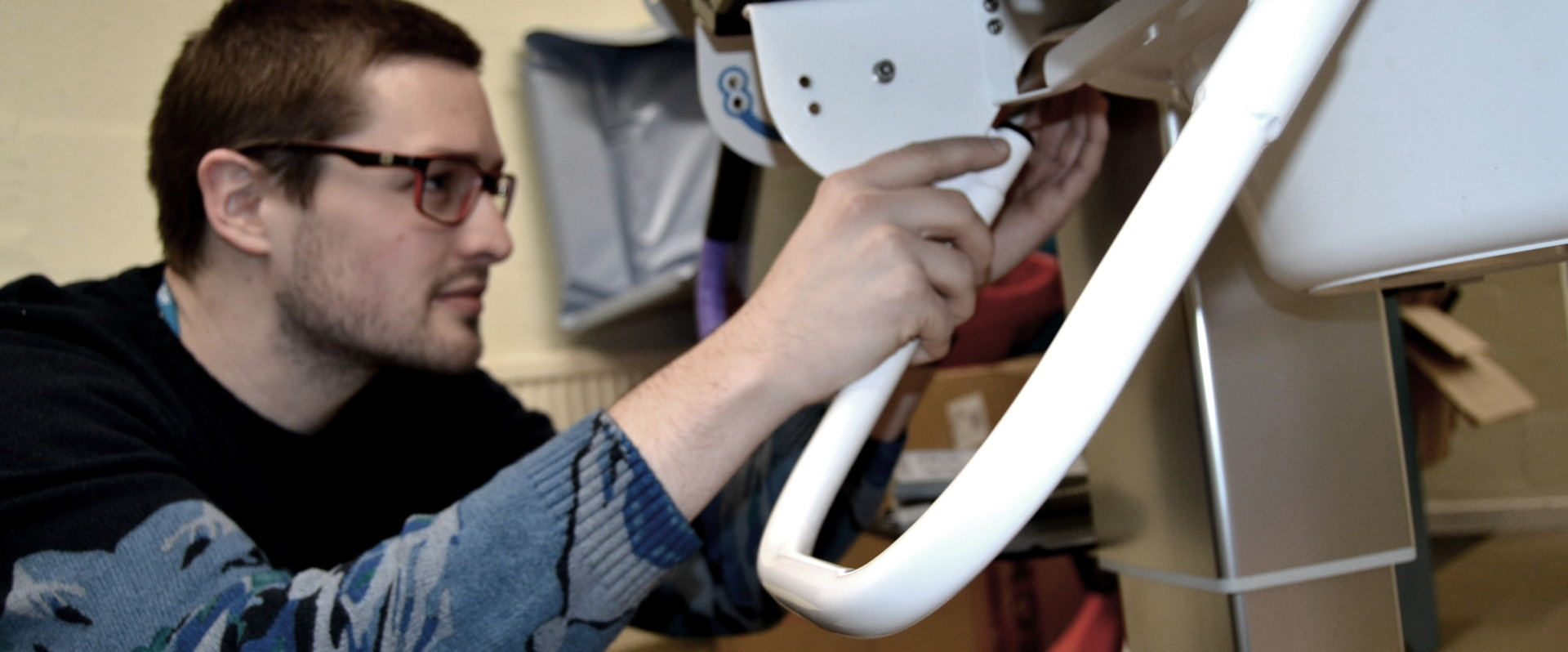 A design engineer working on a bespoke solution in our workshop
