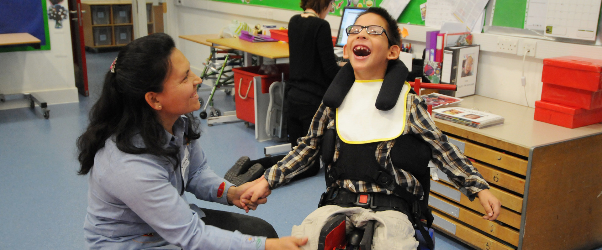 Happy chid in assistive mobility device