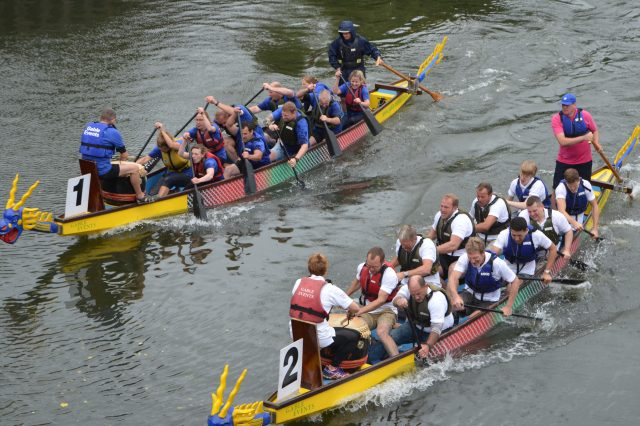 Two teams in dragon boats in the River Avon