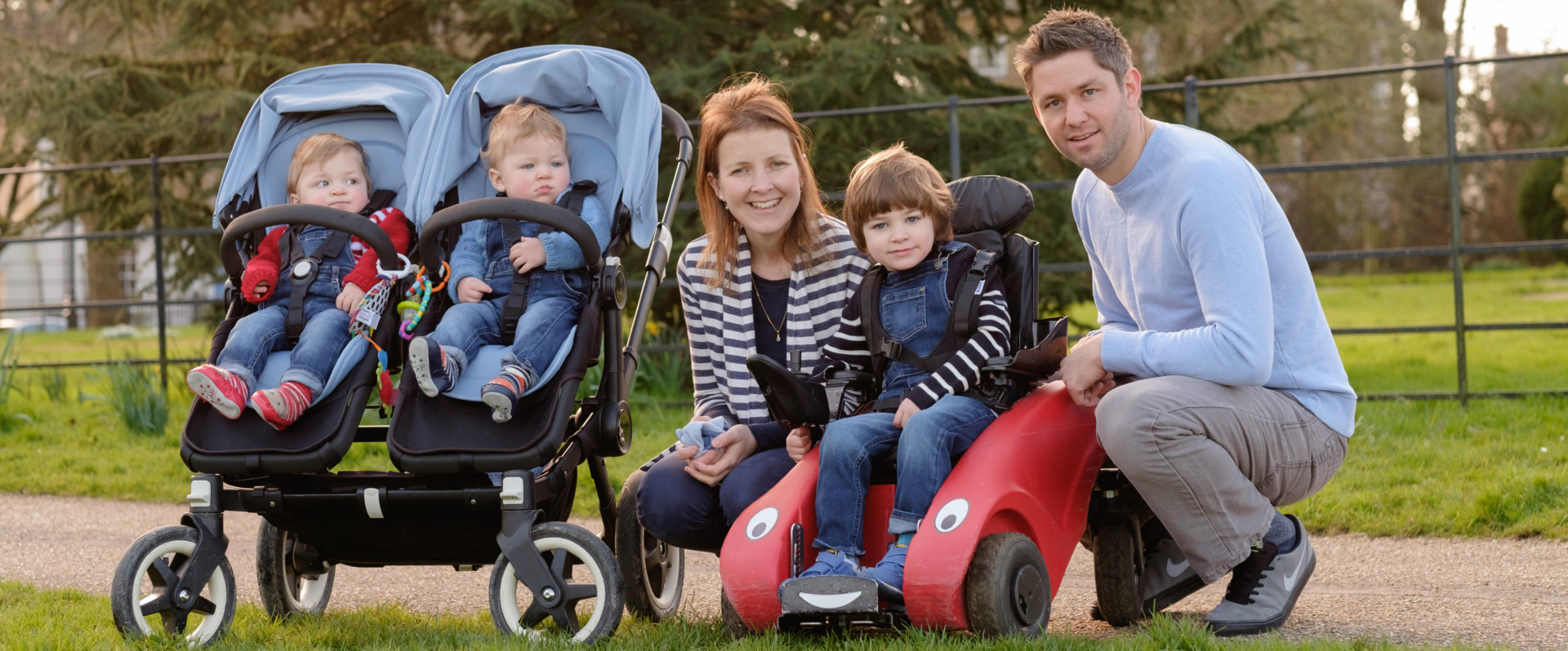 A family in the park with a Wizzybug