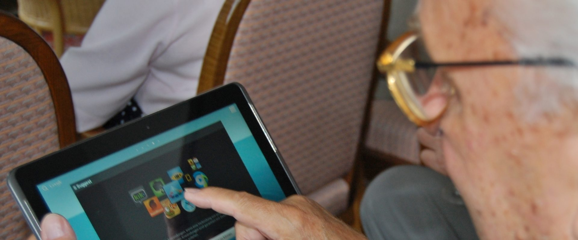 Older gentleman using an app on a tablet computer