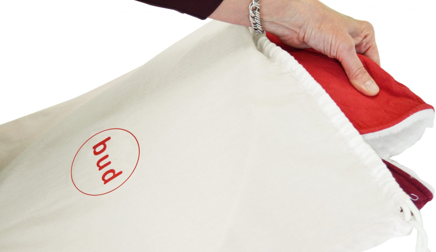A hand pulling a Bud sensory cushion out from its bag