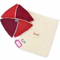A Bud sensory cushion closed up with a carry bag and accessories