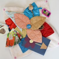 An open Bud sensory cushion featuring items relating to gardening