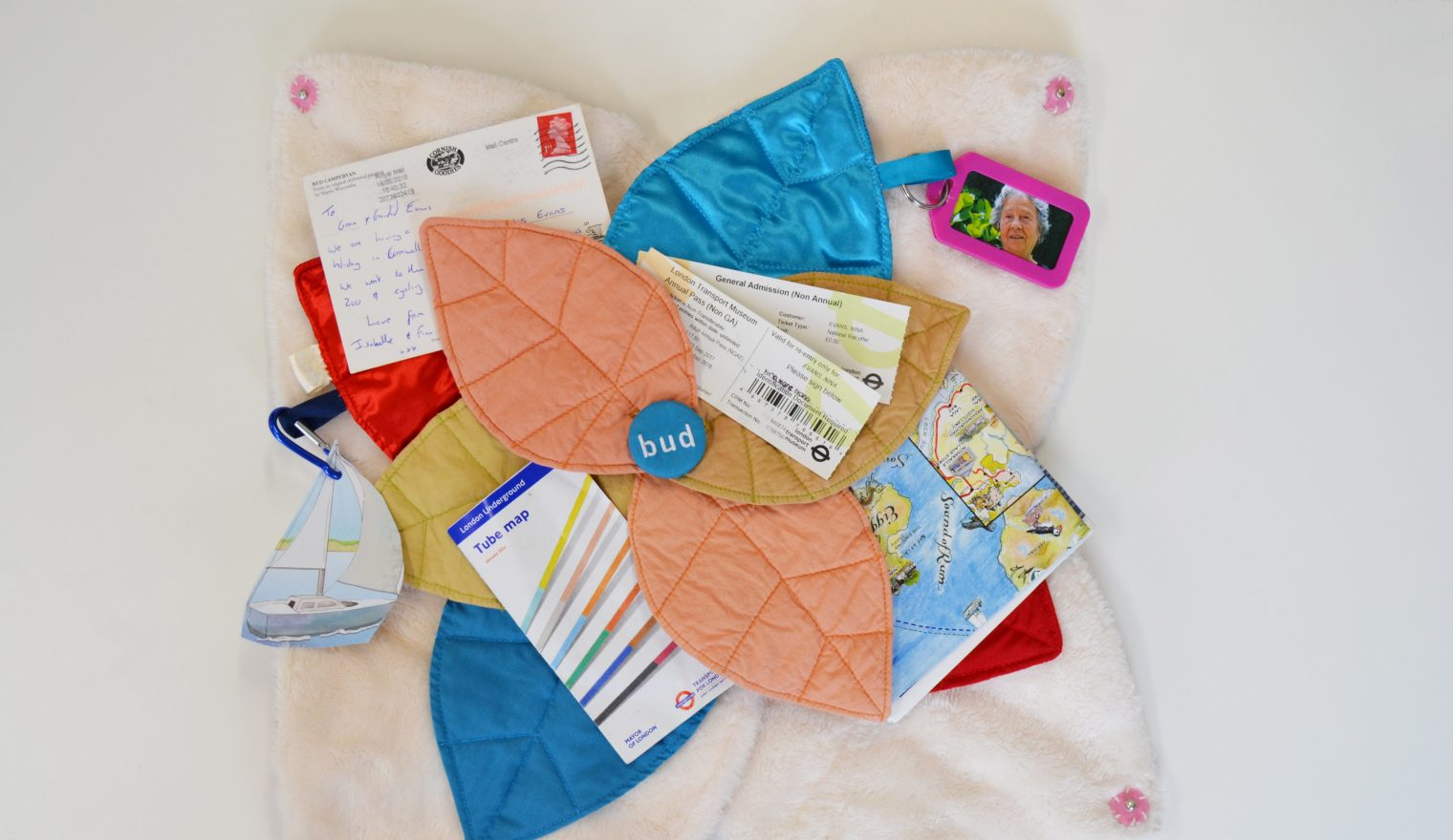 An open Bud sensory cushion holding personal items relating to travelling