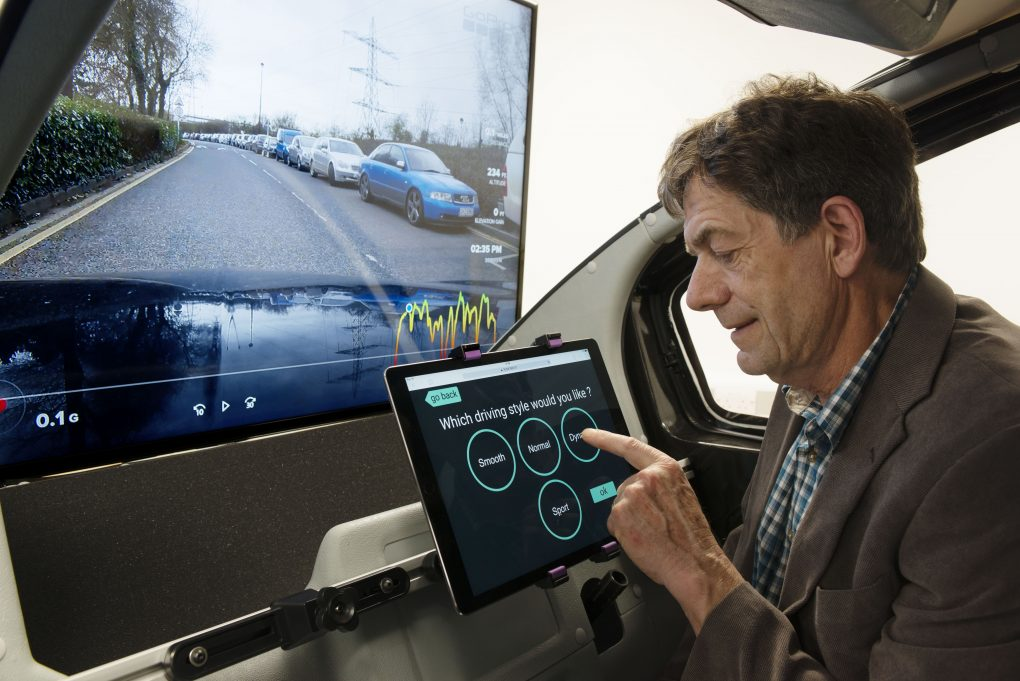 Man selects driving options from Human Machine Interface device