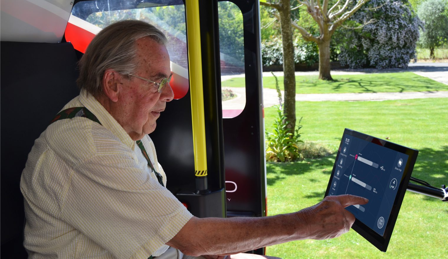 Older man using human machine interace in a driverless car