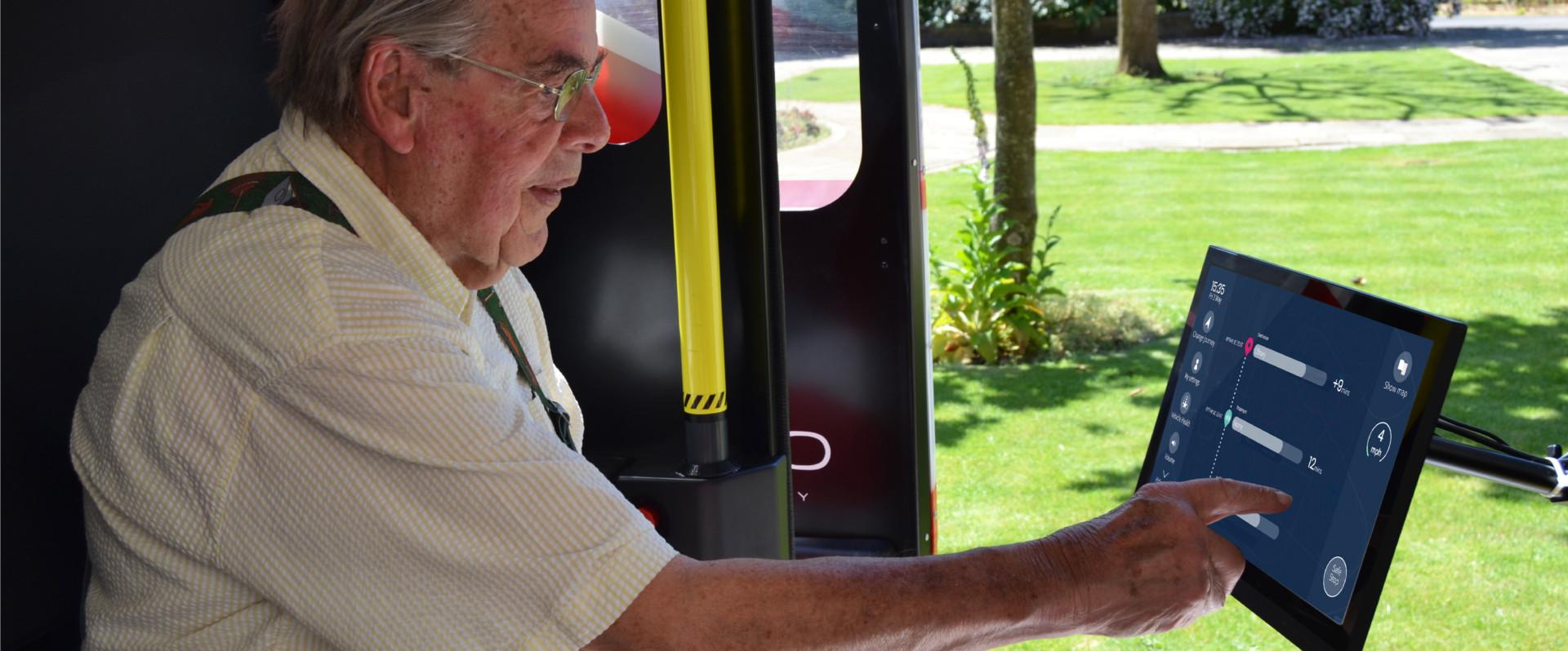 Older man using human machine interace in a driverless car