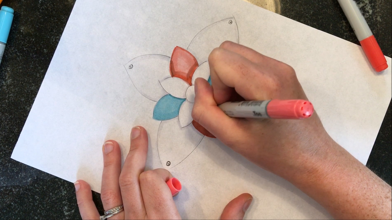 Hands sketching a Bud Sensory Cushion
