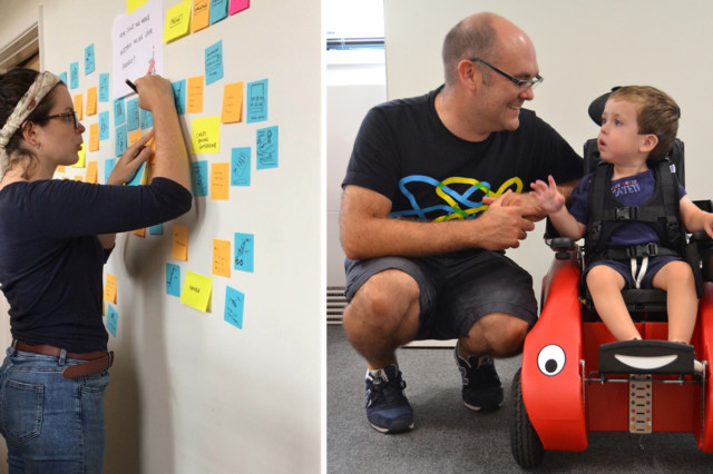 Product designer sketching on post-it wall next to a father and son (son is seated in a Wizzybug powered wheelchair)
